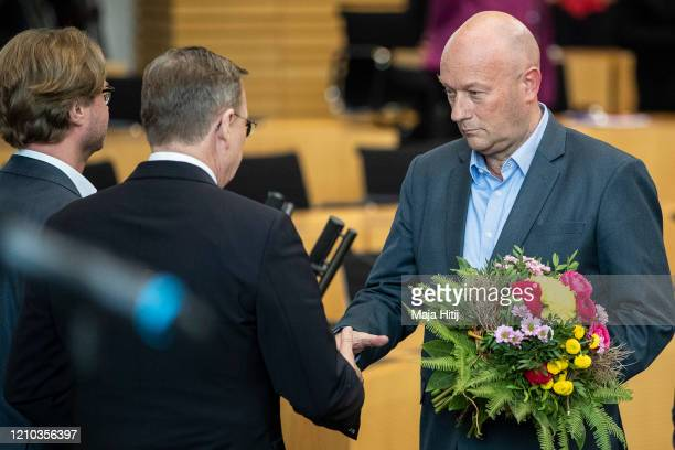 Bodo Ramelow leader of the leftwing Die Linke political party in Thuringia is congratulated by Thomas Kemmerich of FDP after being elected new...