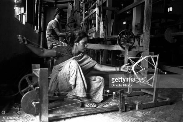 Bodo woman weaving threads, Assam, India
