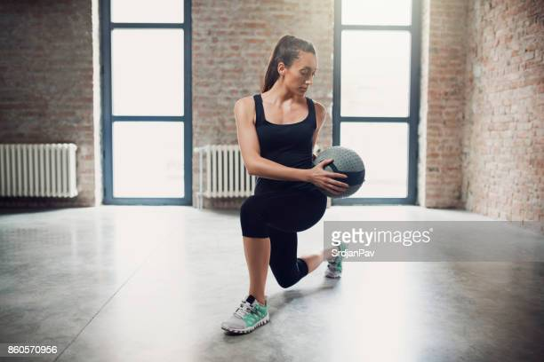 body achieves what mind believes - medicine ball stock pictures, royalty-free photos & images