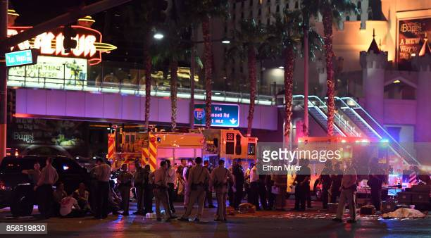 A body appears to lie under a sheet as police and rescue personnel gather at the intersection of Las Vegas Boulevard and Tropicana Ave on October 1...