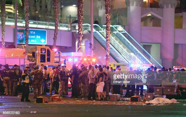 A body appears to lie under a sheet as police and rescue personnel gather at the intersection of Las Vegas Boulevard and Tropicana Ave after a...