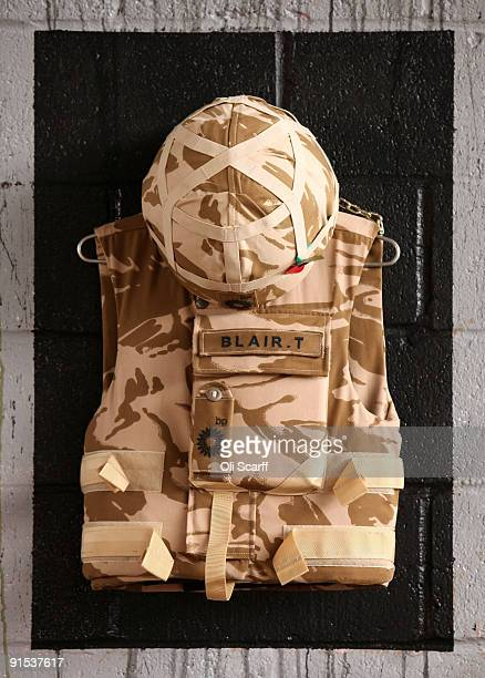 Body armour created by artist 'War Boutique' adorns the wall in the 'One Foot in the Grove' exhibition of street art by 'Mutate Britain' under the...