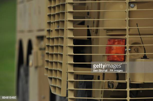 Body armour fitted to a truck in the form of heavy duty metal grids causing antitank weapons to detonate further from the body of the vehicle and...