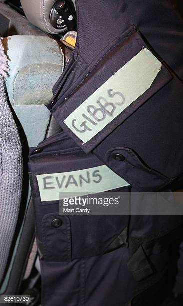Body armour in a RAF Hercules at Al Udeid Air Base belonging to rugby players Scott Gibbs and Ieuan Evans is hung on a seat in a RAF Hercules on...