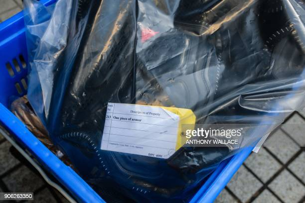 Body armour is seen in a box of evidence being delivered to the High Court for the case of proindependence protestors including Edward Leung who are...