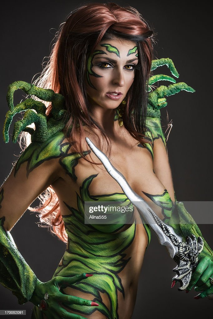 Body art: Alien goddess with sword : Stock Photo
