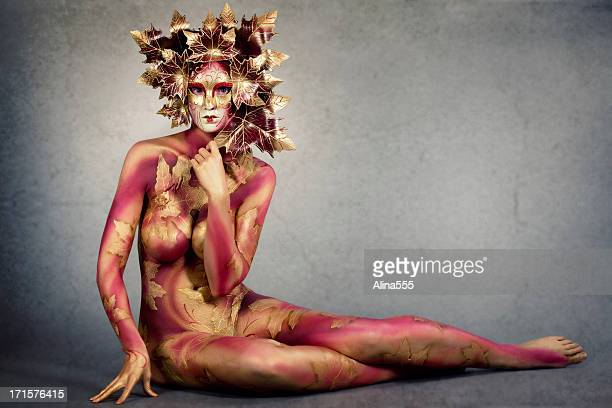 Body art: woman with bodypainting wearing a mask