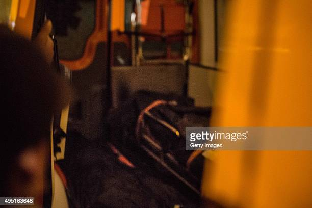 A body bag containing a corpse of a victim retrieved from a Russian plane crash is stored inside an ambulance on October 31 2015 in Cairo Egypt A...