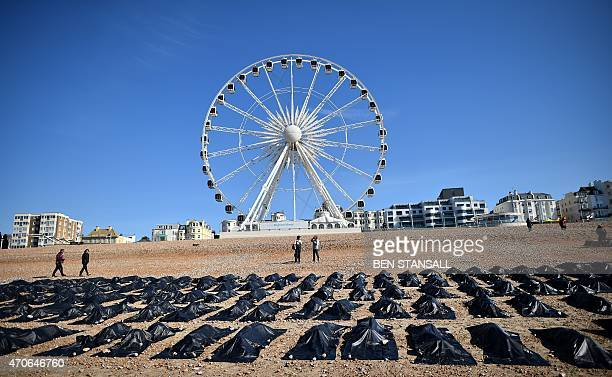 'Body bags' are pictured on Brighton beach in southern England on April 22 during a photocall by Amnesty International to highlight what they claim...