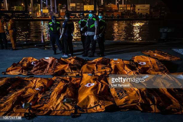 Body bags containing remains of passengers from Lion Air flight JT 610 are laid out at the Tanjung Priok port on November 4 2018 in Jakarta Indonesia...