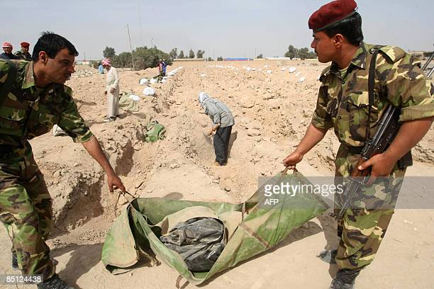 Body bags containing the remains of a killed Iraqi soldier are laid out for burial at a cemetery close to the southern city of Basra some 550 kms...