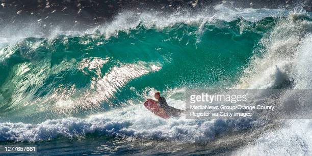 Body boarder attempts to ride a large wave at the Wedge in Newport Beach on Wednesday, September 30, 2020.