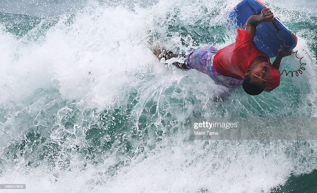A body boarder rides a wave near Arpoador Beach on March 25, 2014 in Rio de Janeiro, Brazil. Autumn has arrived in Rio bringing with it much needed rains and increased surf in some areas.