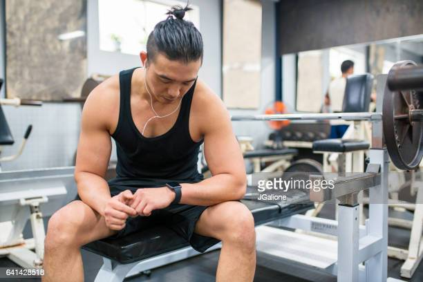 Body builder checking his vitals on a smartwatch