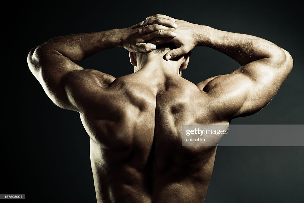 Body Builder Demonstrating his Muscular back : Stock Photo