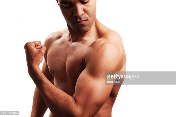 Body builder flexing biceps
