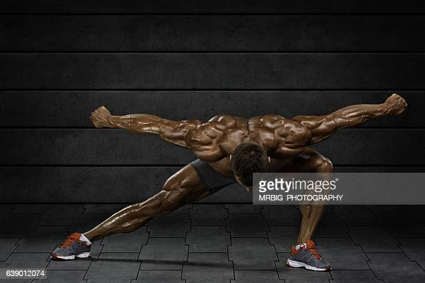 Body Builder Flexing Muscles
