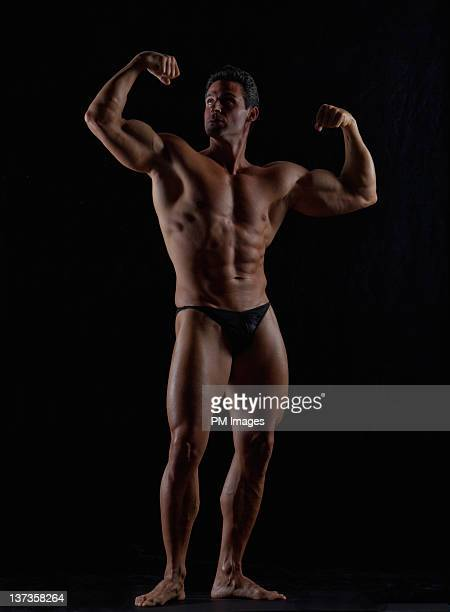 body builder posing - man wearing speedo stock photos and pictures