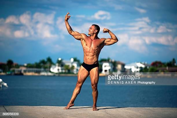 Body Builder Posing waterfront