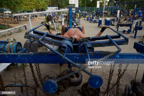 Body builders students and citizens of all age train in the Kachalka open air gym on August 25 2017 in Kiev Ukraine The outdoor gym is free for...