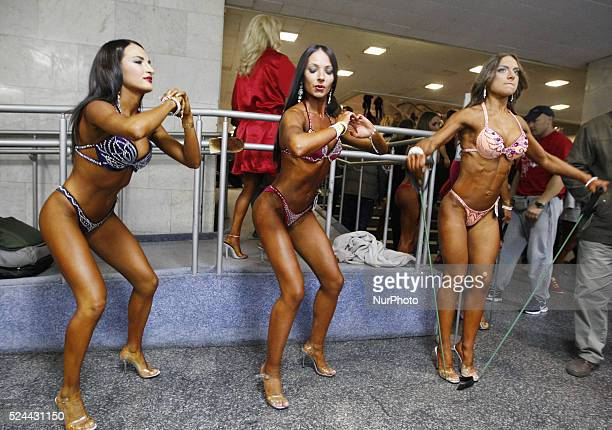 Body builders train backstage during the Cup of Kiev of bodybuilding classic bodybuilding physicist and body fitness and bikini in Kiev Ukraine 10...