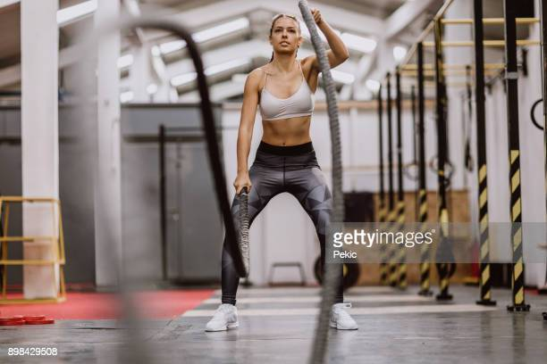 body building battle ropes - sports training stock pictures, royalty-free photos & images
