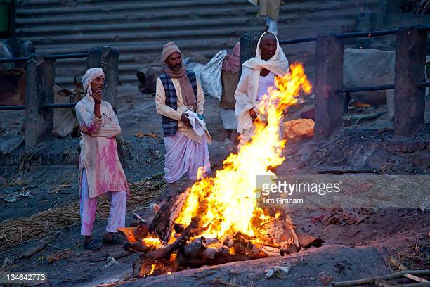 Body burning on funeral pyre at Hindu cremation at Manikarnika crematorium Ghat in Holy City of Varanasi, Benares, India
