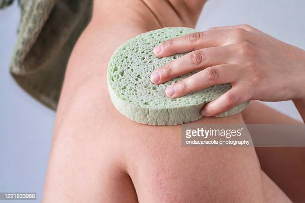 body cleaning - fat women in bath stock pictures, royalty-free photos & images
