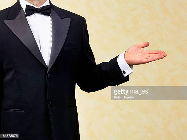body guard, bouncer, doorman, waiter, welcoming - smoking stock-fotos und bilder