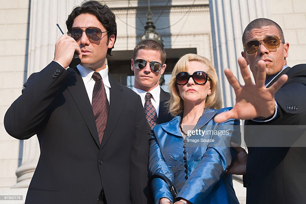 Body guards protecting a woman : Stock Photo