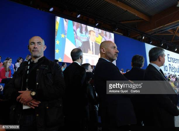 Body guards secure the meeting of French Presidential Candidate Emmanuel Macron arrives for a political meeting at Grande Halle de La Villette on May...