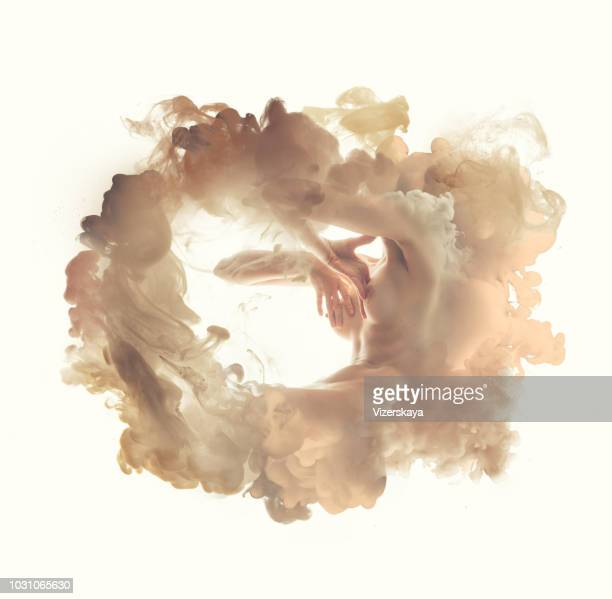 body in smoke - mani su seno foto e immagini stock