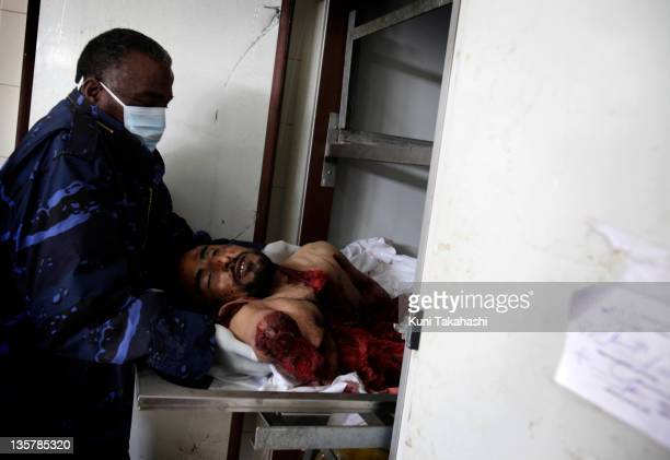 A body is handled at hospital February 25 2011 in Benghazi Libya The oppositions against Gaddafi took control of the city early this week