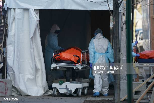 Body is moved to a refrigerator truck serving as a temporary morgue outside of Wyckoff Hospital in the Borough of Brooklyn on April 4, 2020 in New...