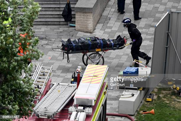 A body is removed from Grenfell Tower on June 16 2017 in London England 30 people have been confirmed dead and dozens still missing after the 24...