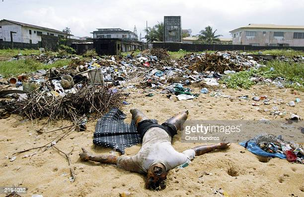 A body lies dicarded at a rubbish dump at the beach July 24 2003 in Monrovia Liberia Hundreds of Liberians have been killed in recent days in fierce...