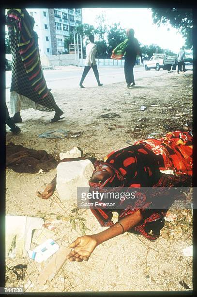 A body lies in the street December 6 1993 in Mogadishu Somalia US gunships attacked the compound of warlord Mohammad Aidid in response to attacks on...