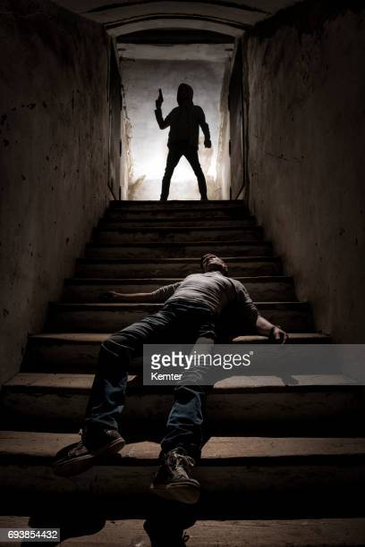 body lying on the stairs and the killer standing on the top