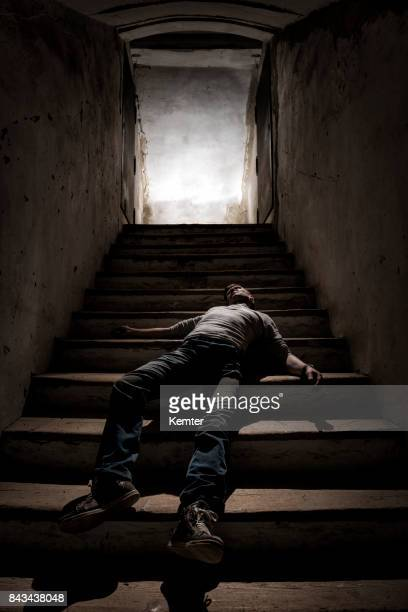 body lying on the stairs - dead man stock pictures, royalty-free photos & images