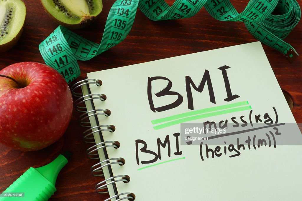 BMI body mass index written on a notepad sheet. : Stock Photo