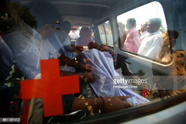 Body of 16 year boy Jiladil Yadav in an ambulance Locals fig to stop an ambulance carrying the body of 16 year boy Jilajit Yadav who died in an...