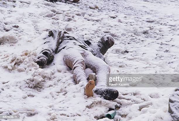 Body of a dead Iraqi soldier with one foot naked lies covered in snow after Iranian troops counter offensive inside Hajomran territories in noerthern...