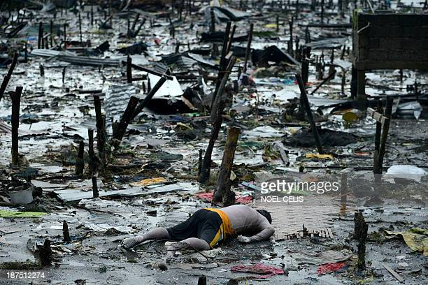 Body of a dead man is seen at the bay of Tacloban, eastern island of Leyte on November 10, 2013. A super typhoon that destroyed entire towns across...