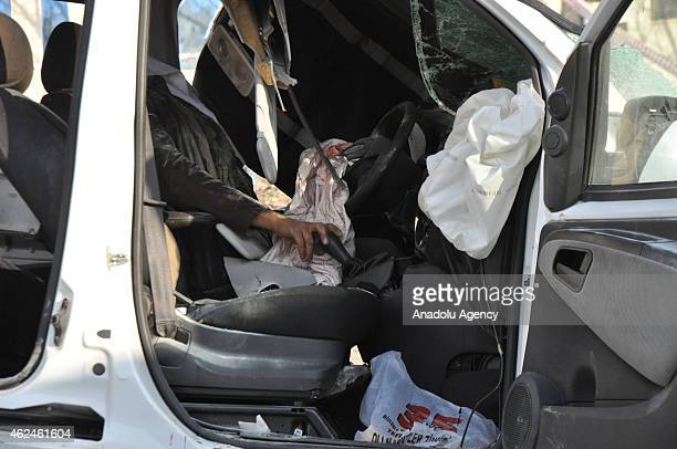 A body of a driver is seen following a car accident in Sanliurfa Turkey on January 29 2015 A Japanese translator also died in the accident