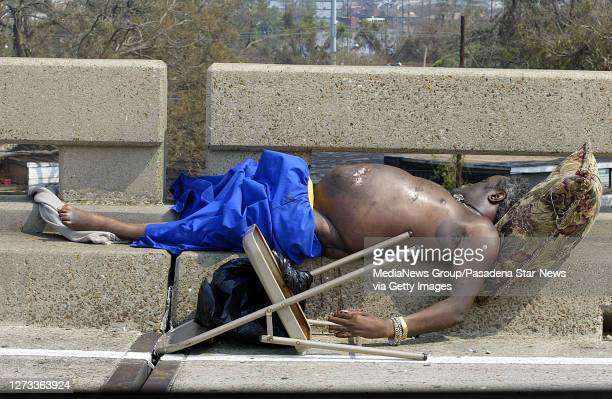 Body of a man who was killed during the hurricane was left on Interstate 10 just north of the SuperDome during the aftermath of Hurricane Katrina...
