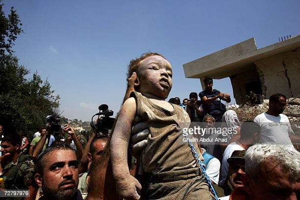 A body of a one year old boy killed in Israeli air strike is paraded through the streets on July 30 2006 in Qana Lebanon