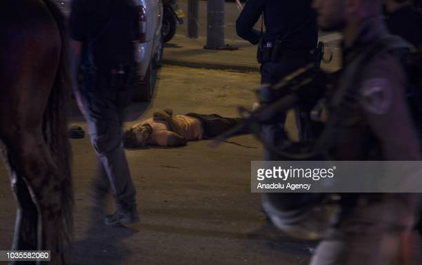 Body of a Palestinian lies on a road after being shot dead near Damascus Gate in Old City in East Jerusalem on September 18 2018 Israeli police...