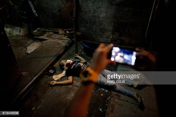 A body of an alleged drug dealer lies on the ground gunned down by an unidentified killer in Manila on September 25 2016 Philippine President Rodrigo...