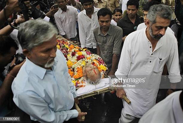 Body of Indian Bollywood veteran actor Pran is being taken for the cremation at Shivaji Park Crematorium Dadar on July 13 2013 in Mumbai India...
