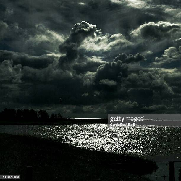 Body of water with thick clouds.